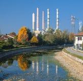 Turbigo Milan: chimneys and canal. Turbigo Milan, Lombardy, Italy: industrial chimneys along the Naviglio Grande royalty free stock image