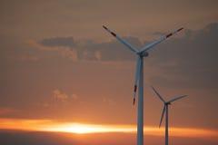 Turbina di vento al tramonto Fotografia Stock