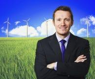 Turbina do homem e de vento Imagens de Stock Royalty Free