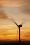 Turbinas de vento no por do sol Imagens de Stock Royalty Free