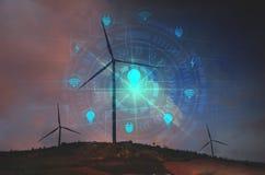Turbinas de viento con las pantallas virtuales del icono debajo del cielo para el techno Fotografía de archivo libre de regalías