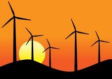 Turbinas de viento en fondo de la puesta del sol Imagen de archivo libre de regalías