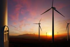 Turbinas de viento en la puesta del sol Imagen de archivo libre de regalías