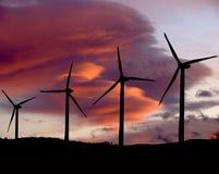 Turbinas de viento en la puesta del sol dos Fotografía de archivo libre de regalías