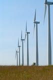 Turbinas de viento en una fila Fotografía de archivo libre de regalías