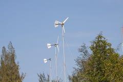 Turbinas de viento en una granja Imágenes de archivo libres de regalías