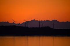 Turbinas en puesta del sol Foto de archivo libre de regalías