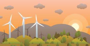 Turbinas y puesta del sol de viento en bosque de la tarde en la colina y el cielo del fondo Foto de archivo libre de regalías