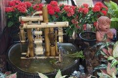 Turbinbalerbambu och dockalergods för garnering i gar Royaltyfria Bilder