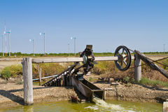 Turbine bail, wooden irrigation tool Royalty Free Stock Images