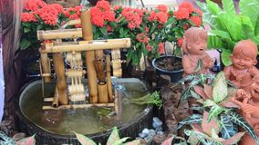Turbine baler bamboo and dolls earthenware for decoration in garden. At Nonthaburi, Thailand stock video