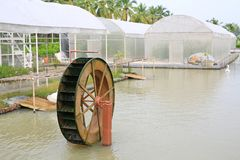 Turbine baler in the garden. Good environment water treatment concept.  royalty free stock image