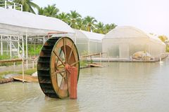 Turbine baler in the garden. Good environment water treatment concept.  stock images