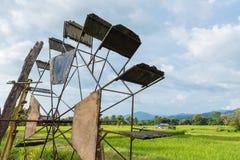 Turbine baler in paddy rice field.Thailand. Royalty Free Stock Photo