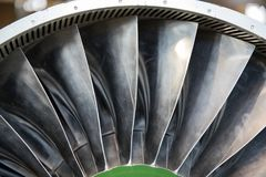 Turbine blades of turbo jet engine for plane, aircraft concept in aviation industry.  stock photo