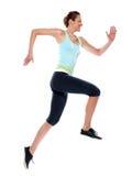Turbine de passage de fonctionnement de femme sprinting Images libres de droits