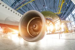 Turbine engine blades during maintenance, the plane in the hangar.  royalty free stock photography