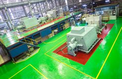 Turbine machine in power plant room to generate energy ,power electricity. Electric generators. Machine in sugar mill factory on production line. - Factory royalty free stock image
