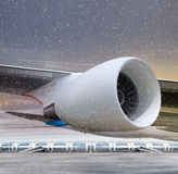 Turbine of plane at non-flying weather. Airport and white plane at non-flying weather, winter time Royalty Free Stock Image