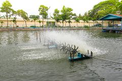 The turbine in a pond working Mechanical oxygenation in water. stock image