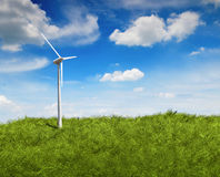 Turbine power generator on grass field Royalty Free Stock Photography
