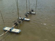 Turbine rotates the surface to increase oxygen in fish pond and shrimp pond. Turbine and shrimp farming techniques. Water oxygen g. Enerator royalty free stock photos