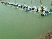Turbine rotates the surface to increase oxygen in fish pond and shrimp pond. Turbine and shrimp farming techniques. Water oxygen g stock photography