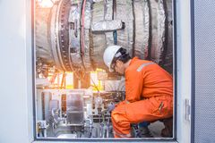 Turbine technician check and inspection gas turbine engine of electric power generator to cross check before startup. royalty free stock photos