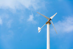 Turbine white on blue sky Stock Photography