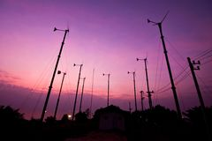 Turbine wind mill in sunset Stock Photos