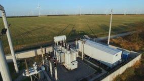 Turbine windmill electricity generator. Elektrische Unterstation. Aerial shot of turbine windmill electricity generator, power plant Power plant against the stock video footage