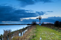 Turbine windmill by lake, Groningen Royalty Free Stock Photography