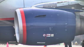 Turbine on the wing of a Boeing 747 at the airport stock footage