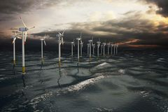 Turbiner för väderkvarnlantgårdvind som frambringar elektricitet på havet Arkivfoton