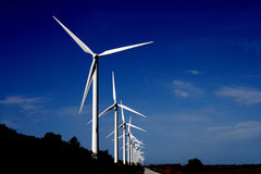Turbines. Row of white wind turbines Royalty Free Stock Image