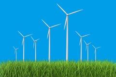 Turbines de vent dans le domaine d'herbe Photos stock