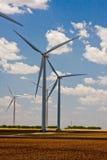Turbines et nuages Image stock