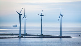 Turbines on island of offshore wind farm Royalty Free Stock Image