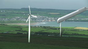 Turbines located in a rural area as they spin stock video footage