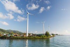 Turbines at wind farm on sea shore Royalty Free Stock Photos