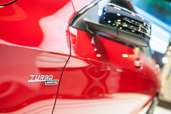 Turbo badge of Mercedes-Benz CLA45 AMG at the Singapore Motorshow 2015 Stock Images