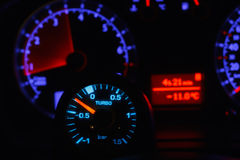 Turbo boost gauge and blurry unfocused speedometer. Turbo boost gauge and blurry defocused speedometer Stock Photo