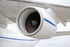 Turbo-jet engine under the wing of an airplane Stock Photos