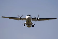 Turbo-prop airplane. Landing - frontview Royalty Free Stock Photography