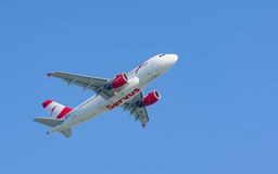 Turbojet airplane Airbus A319 of Austrian Airlines gaining altitude Stock Photos