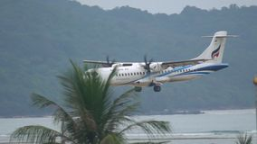 Turboprop aircraft approaching. PHUKET, THAILAND - DECEMBER 1, 2016: Bangkok Airways ATR 72-600 HS-PZE approaching before landing at Phuket airport stock video footage