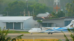 Turboprop aircraft begin taxiing. PHUKET, THAILAND - DECEMBER 2, 2016: Bangkok Airways ATR 72-600 HS-PZF before take-off from Phuket airport. View from the top stock video footage