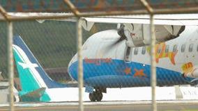 Turboprop aircraft at the start of the executive. PHUKET, THAILAND - NOVEMBER 26, 2015: Bangkok Airways ATR 42 HS-PGC before take-off from Phuket airport stock footage