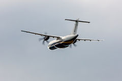 Turboprop aircraft taking off. Commercial turboprop aircraft taking off stock photography