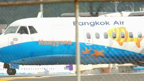 Turboprop aircraft taxiing to the start of the. PHUKET, THAILAND - NOVEMBER 26, 2015: Bangkok Airways ATR 42 HS-PGC before take-off from Phuket airport stock video footage